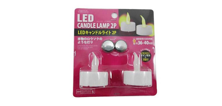 Luminária LED em formato de vela Daiso